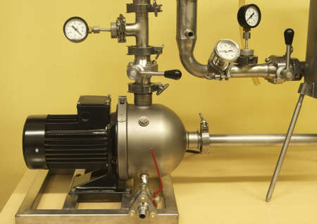 Pump, connecting pipes and control elements - a part of biomass separation unit photo
