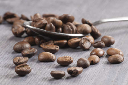 Coffee beans on an old wooden table, close-up