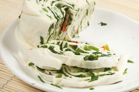 White cheese (brynza) roll with greenery and paprika