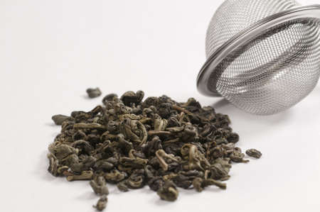 strainer: Green tea and a strainer for brewing Stock Photo