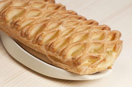 Apple jam pie on a dish, close-up