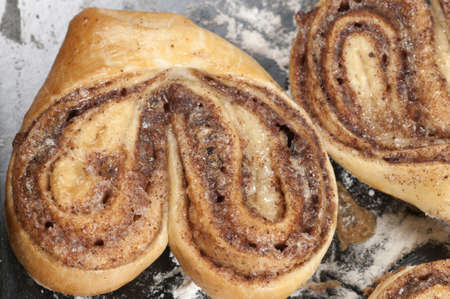 cookie sheet: Cinnamon buns after baking on a cookie sheet Stock Photo