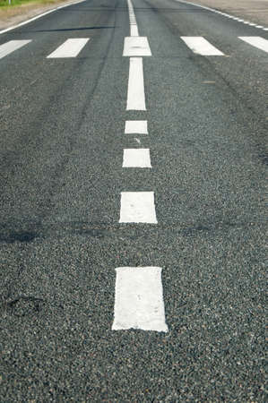 formatting: Middle of the asphalt road with marking