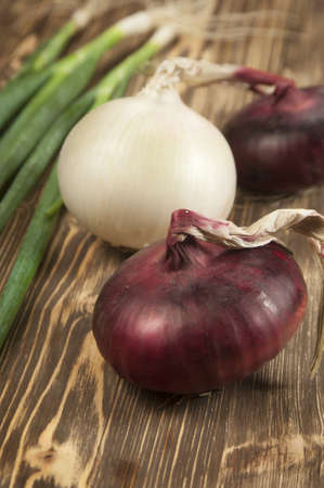 Red and white sweet onions on a wooden table