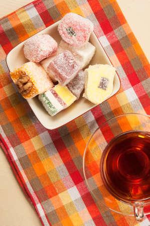 assort: Lukum (Turkish Delight) assort and a cup of tea Stock Photo