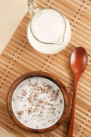 kasha: Buckwheat kasha with milk on a table with napkin