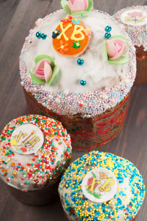 Four Easter cakes on a wooden table Stock Photo