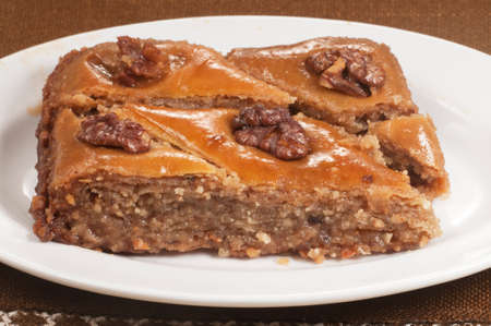 Baklava with walnut on a plate and brown napkin, closeup shot Stock Photo