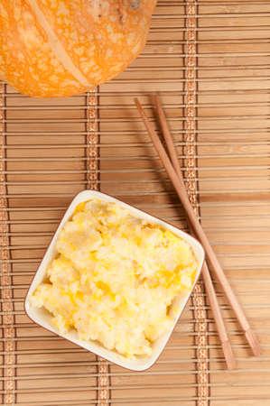 kasha: Rice kasha with pumpkin in a ceramic bowl Stock Photo