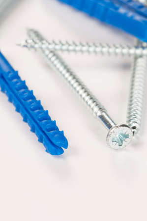 tapper: Rawbolts with wall dowels, closeup shot, local focus Stock Photo