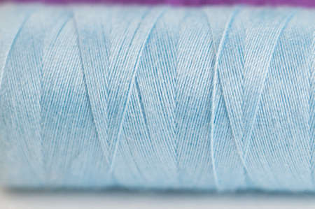 needlecraft product: Sewing strings on a light background, macro shot, local focus
