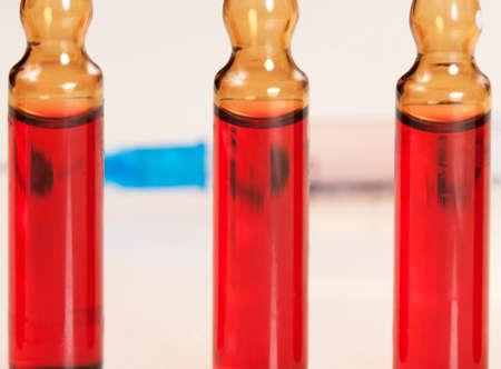 ampules: Syringe and ampules, close-up shot, local focus Stock Photo