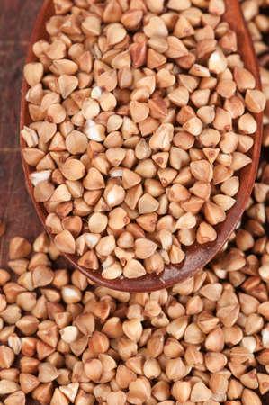 kasha: Buckwheat grain (raw), closeup shot, local focus