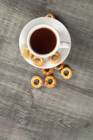 strewed: Dried biscuits and tea on timber table, close up