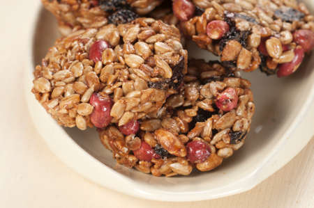 brittle: Brittle from assorted ingredients - peanut, raisins and sunflower seeds Stock Photo