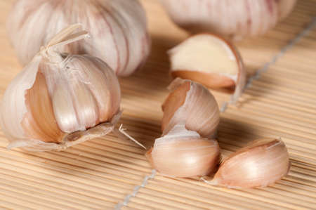 Garlic on a timber table Stock Photo