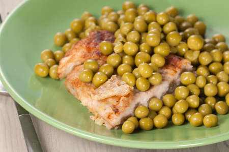 green pea: Pork chop with green pea, close up shot Stock Photo