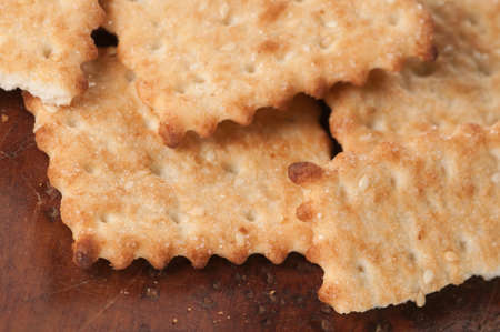 sesame cracker: Salted cracker with sesame on a board, close up