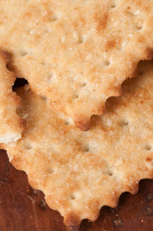 assort: Salted cracker with sesame on a board, close up