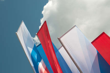 color scale: Decoratine flags in Russian color scale outdoors, the sky and clouds