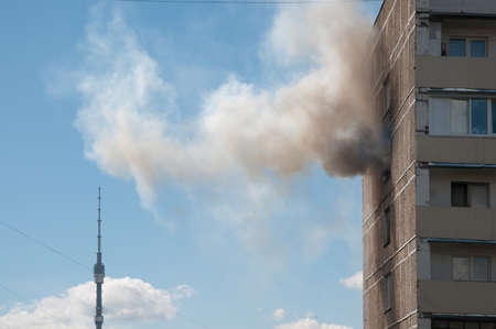 hardship: MOSCOW, RUSSIA, JULY 07. 2016: - Big fire in apartment building on Pavla Korchagina street, 7, late stage