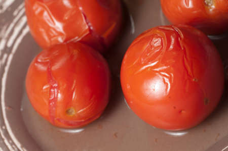 Marinated tomatoes on a plate, close up shot