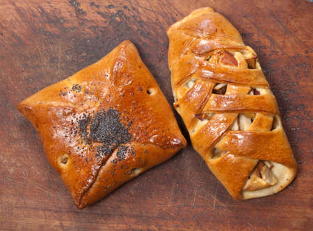 Two apple pies on a timber board, close up Stock Photo
