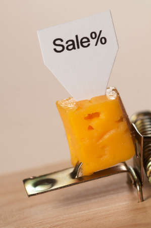 Sale of cheese in a mousetrap, conception of risk and danger Stock Photo