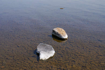 Big stones in clear river water - zen concept