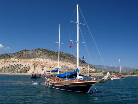 Sea yachts on parking in a bay of Mediterranean sea        Stock Photo