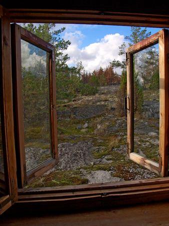 view through: Window opened in wild northern wood of Karelia