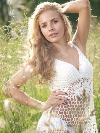 Blonde in white dress photo
