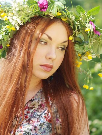 Girl in herbal crown photo