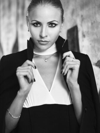 Girl in a jacket black-and-white photo
