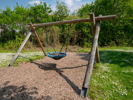swing seat: Lone swing seat in a summer field in Germany Stock Photo