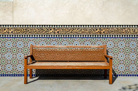 wooden bench with ornaments in an oriental garden