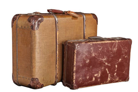 two old-fashioned scratched brown suitcases - white, isolated