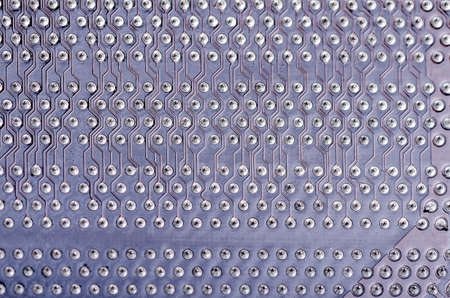 solder joints on a circuit board as pattern or background