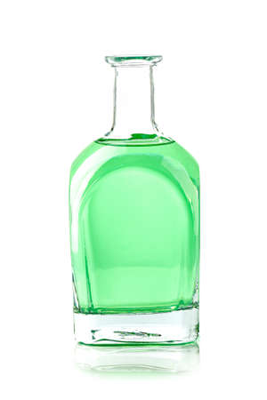 glass bottle with a green liquid on white background
