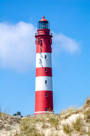red white lighthouse on the north sea 版權商用圖片
