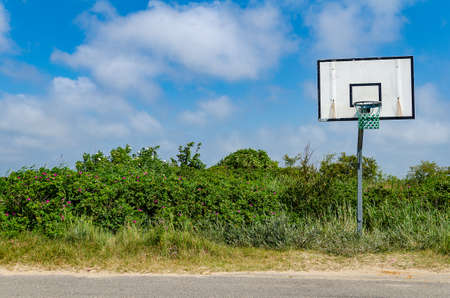 old lonely basketball basket on the roadside, blue sky 版權商用圖片