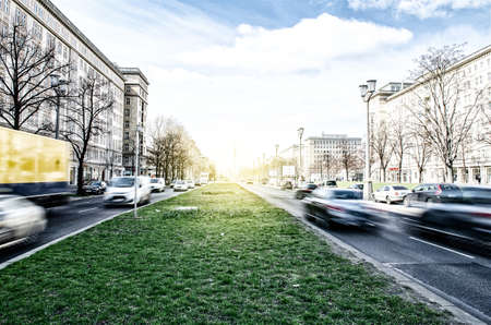 street in berlin with traffic, backlight and blurred