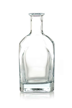 transparent empty glass bottle on a white background, isolated with copy space