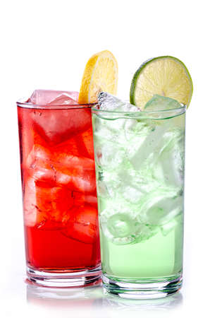 green and red drink with ice cubes and lemon slices on white background, isolated 版權商用圖片