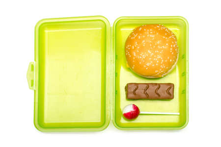 green lunchbox for children with unhealthy content on white background, isolated 版權商用圖片