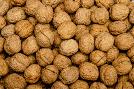 a bunch of brown walnuts
