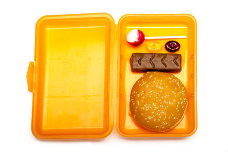 orange lunchbox for children with unhealthy content on white background, isolated