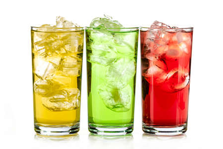 yellow, green and red drink with ice cubes on white background, isolated