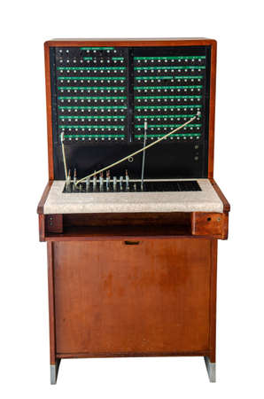 old telefon switchboard in front of a white wall, isolated on white background 版權商用圖片