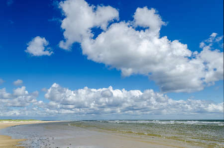 large beach with blue sky and clouds